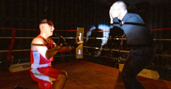 boxer proposes to partner on one knee in boxing ring