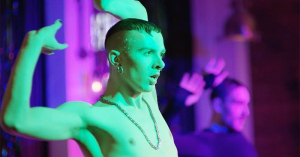 Still from documentary Deep in Vogue: a shirtless man voguing
