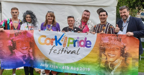 representatives of cork pride hold banner
