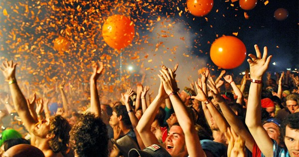 Crowd at a music festival, balloons and confetti in the air. In this piece Lisa Connell speaks about new music festival Love Sensation
