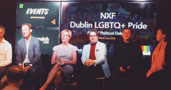 "political equality panel sits in front of screen reading ""NXF Dublin LGBTQ Pride"