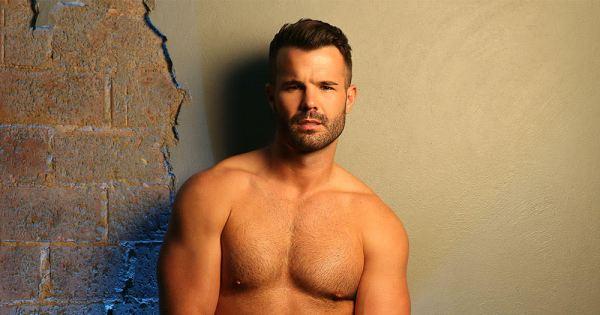 Simon Dunn posing shirtless