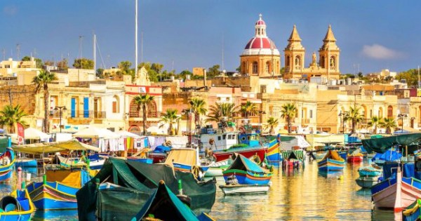 One of the top LGBT+ friendly destinations - a view of boats and Malta's cathedral