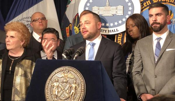 Corey Johnson speaks to a crowd at New York City Hall regarding change to conversion therapy ban