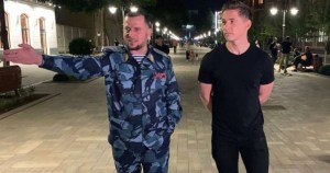 James Longman, wearing a black t-shirt, and Apti Alaudinov, wearing blue army uniform, walking around the capital of Chechnya.