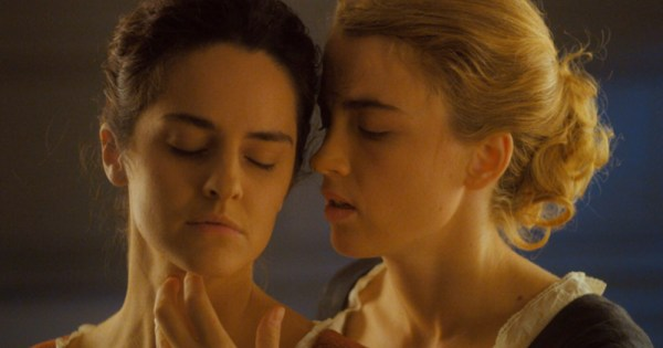 Two female characters from Portrait of a Girl on Fire embracing. It is part of the IFI French Film Festival lineup.