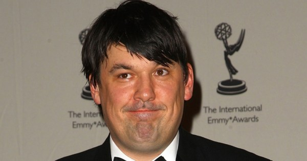 Graham Linehan smiling at the Emmy's. He has recently nominated for D*ck of the Year award.