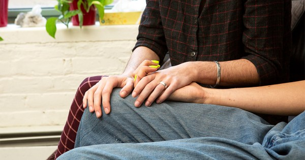Looking after a loved one post top surgery: close up of two people holding hands