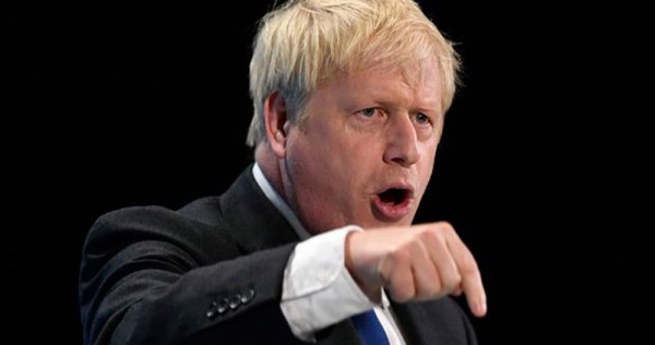 Boris Johnson looking angry and pointing downwards, his party won an overwhelming majority in UK general election.
