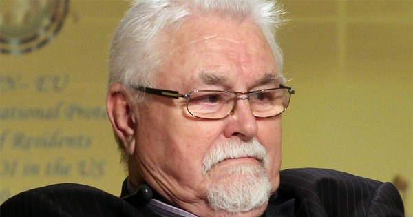 Ken Maginnis - an older white haired man wearing glasses sits with a grumpy expression on his face