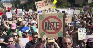 People protesting against hate crime.