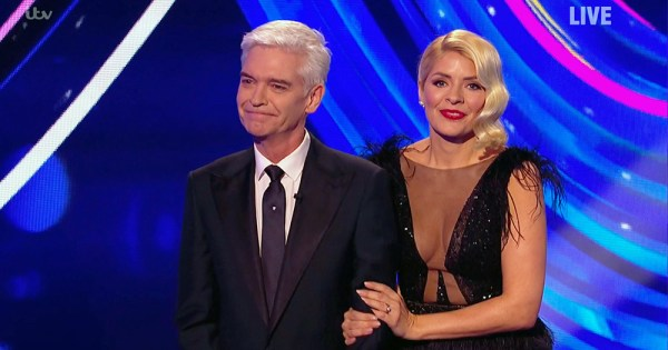 Holly Willoughby holding Phillip Schofield's arm during Dancing on Ice