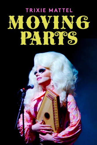 A country and western style drag queen plays an autoharp