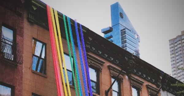 gay coronavirus a house with rainbow ribbon