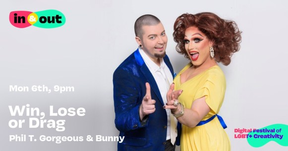 A drag king and a drag queen smiling and pointing at the camera