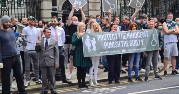 Far right campaigners protesting outside the Dail