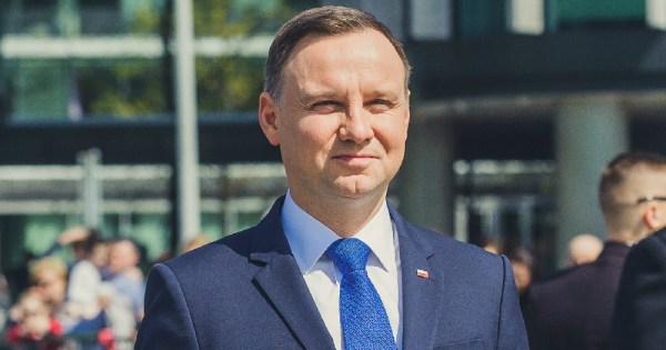 Polish President LGBT+ attack continues: Duda is pictured wearing a blue suit