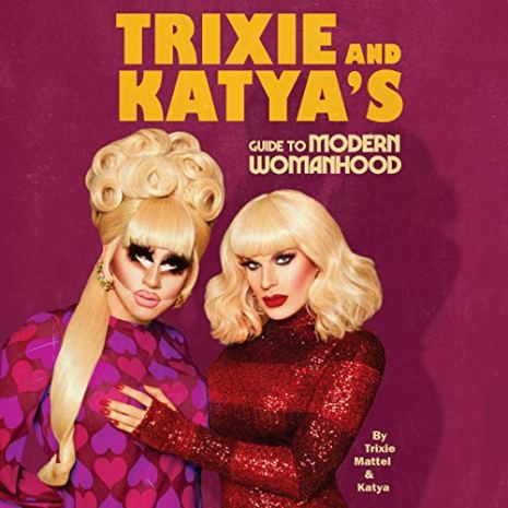 The over of a book featuring two drag queens embracing