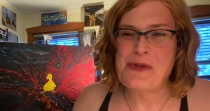 Lilly Wachowski smiling as she speaks to Netflix via webcam in from her home studio