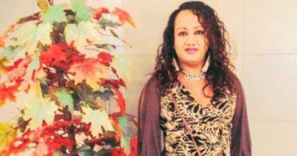 Trans woman from El Salvador, Camila Díaz Córdova, standing beside colourful leaves and smiling, she was murdered last year by three police officers