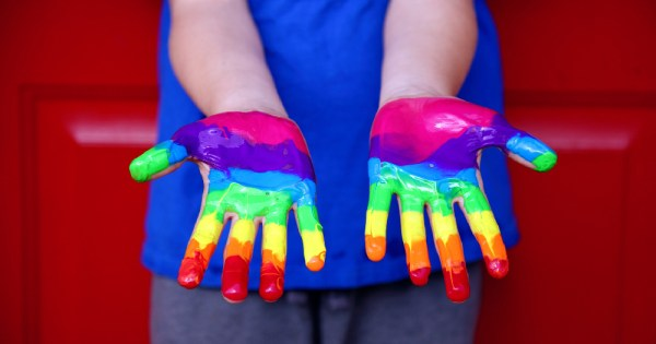 LGBT sex education UK childrens hands covered in rainbow paint