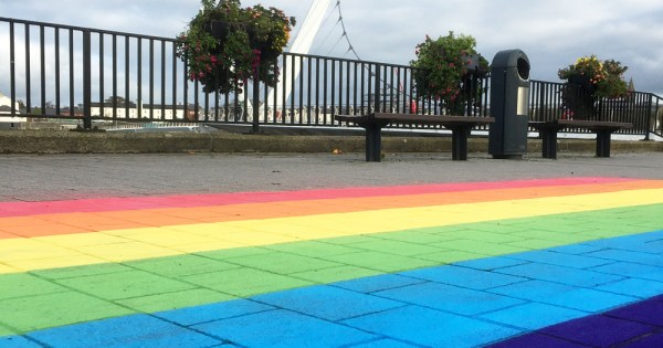 rainbow path painted on the pavement in Derry