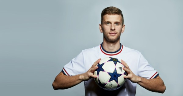 US Soccer player, Collin Martin holding a soccer ball, Collin Martin responds to team's solidarity