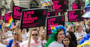 "protest with signs declaring ""love is a human right"", homophobic hate speech rising"