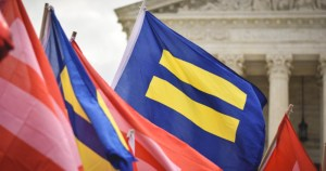 equality and pride flags outside courthouse, Nevada and Arizona fight for LGBTQ+ rights during election.