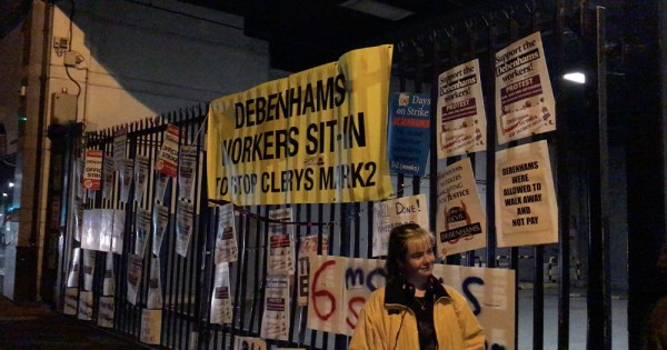 Signs on a fence in support of Debenhams workers