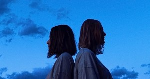 """Two women with their backs against each other. Behind them a dark blue sky. In this piece, Christine Allen explores the complexity of dating someone """"out of your league"""""""