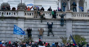 Men scaling the walls of a government building