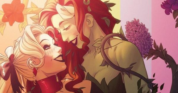 Two cartoon superhero women embrace