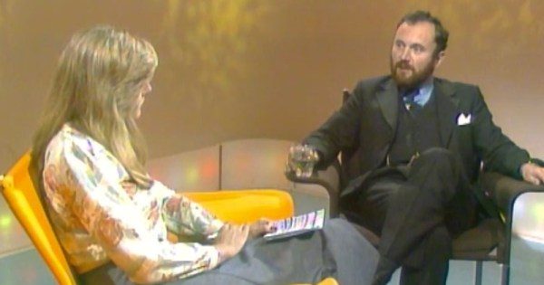 A woman and a man speaking on an old TV chat show