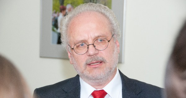 An older man wearing a suit