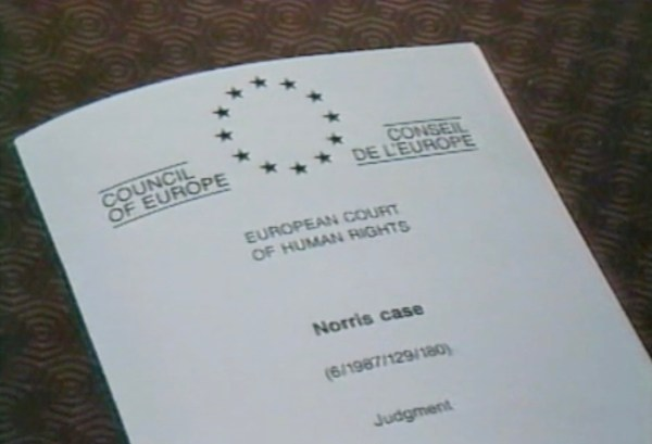 A document from the European Court of Human Rights lays on a table