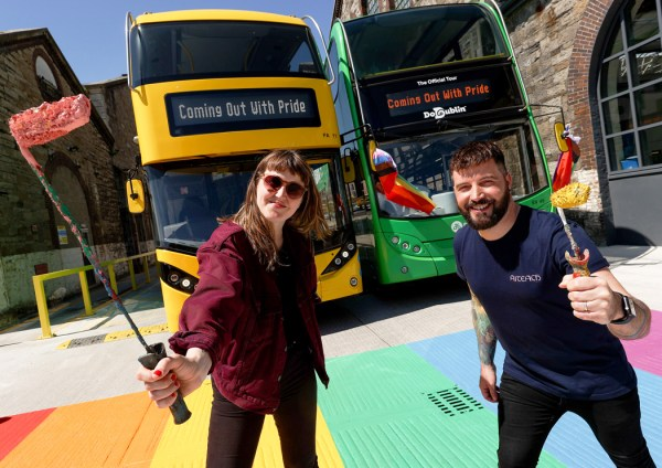 Dublin Bus & GCN launch: a woman and a man pose a top a rainbow crossing