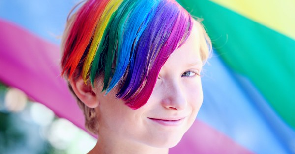 A young person with rainbow dye in their hair