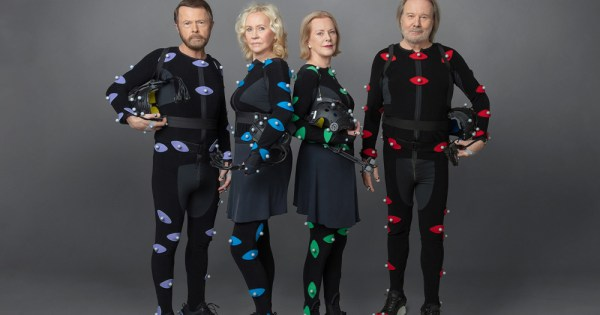 Two men and two women wearing motion capture suits