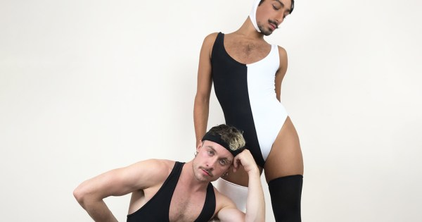 Two men modelling lycra black and white bodysuits posing for the camera