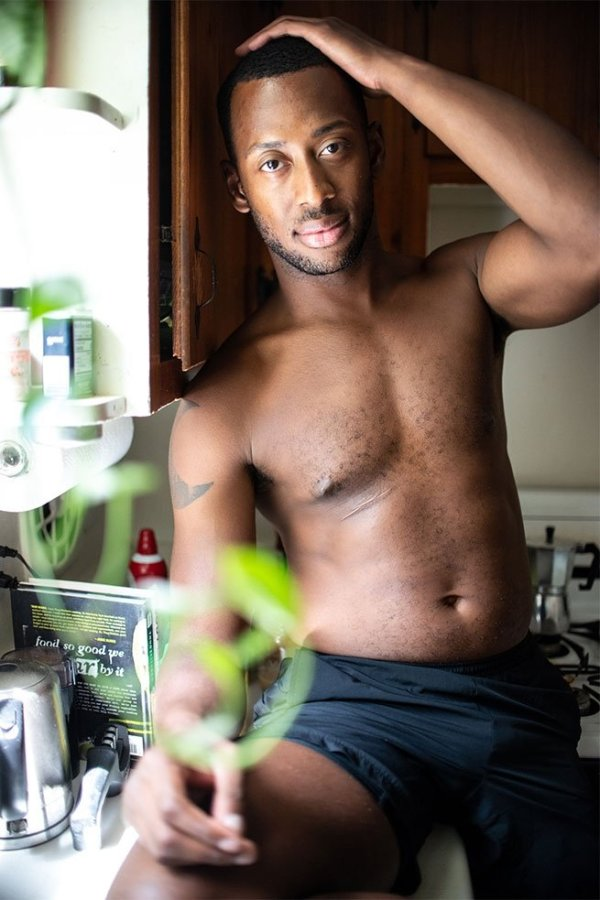 Portrait of a shirtless gay black man wearing short in the latest edition of Elska