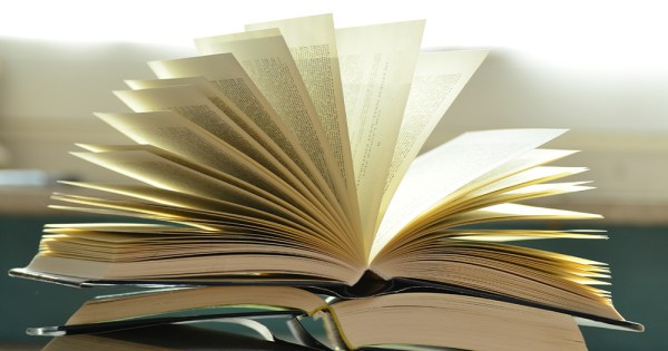 An open book, the pages flipping in a breeze