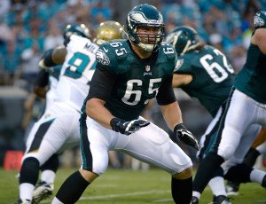 ADVANCE FOR WEEKEND EDITIONS OF DEC. 14-15 - FILE - In an Aug. 24, 2013, file photo Philadelphia Eagles offensive tackle Lane Johnson (65) sets up to block at the line of scrimmage during the first half of an NFL preseason football game against the Jacksonville Jaguars in Jacksonville, Fla. Jason Peters, Evan Mathis, Jason Kelce, Todd Herremans and Lane Johnson don't get much recognition, but coaches and teammates credit the big guys upfront for helping the offense lead the NFL in rushing. (AP Photo/Phelan M. Ebenhack, file)