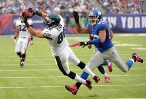 Oct 6, 2013; East Rutherford, NJ, USA; Philadelphia Eagles tight end Zach Ertz (86) catches a pass as New York Giants outside linebacker Spencer Paysinger (52) looks on during the game at MetLife Stadium. Mandatory Credit: Robert Deutsch-USA TODAY Sports