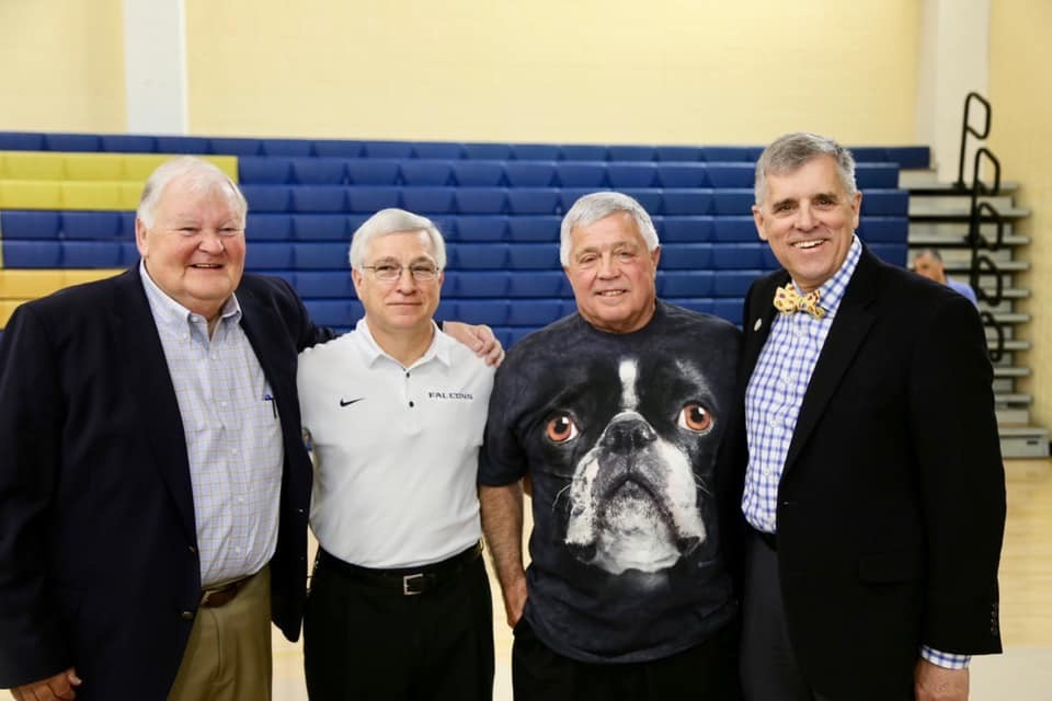 Coach Milloy, Mr. Bates, Carl, and Dr. Barker