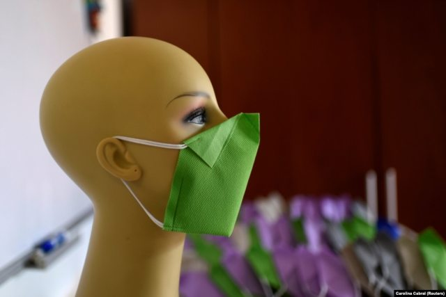A green face mask produced by clothing designers Stalina Svieykowsky and Nelson Jimenez in San Antonio de los Altos, Venezuela
