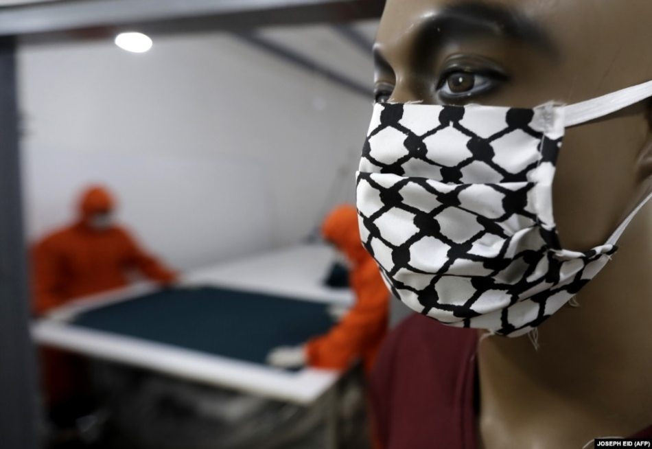 A mannequin wears a face mask with the checkered patterns of the kaffiyeh, the scarf worn by Palestinians to symbolize struggle. This mask was on display at a Palestinian tailor's workshop in the Burj al-Barajneh refugee camp in Lebanon.