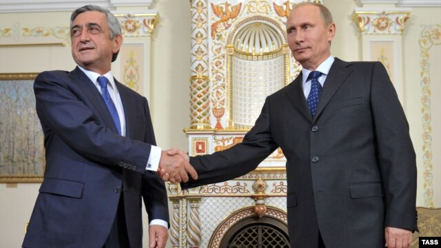 Russian President Vladimir Putin (right) meets with his Armenian counterpart, Serzh Sarkisian, in Moscow on September 3.