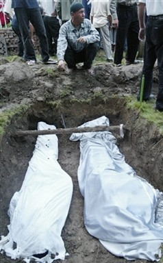 Victims of the crackdown at Andijon are buried on May 14, 2005.
