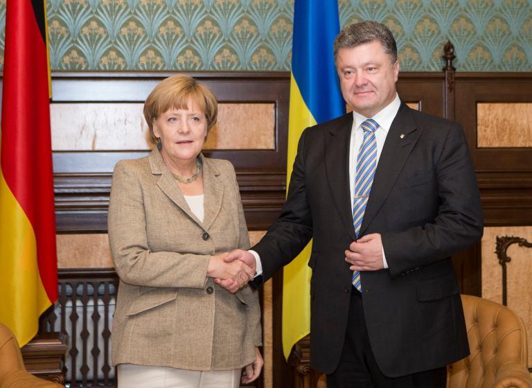 Ангела Меркель и Петр Порошенко 23 августа во время переговоров в Киеве
